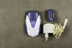 Epilator for depilation of legs by women. Epilator for depilation of hair on legs by women Stock Images