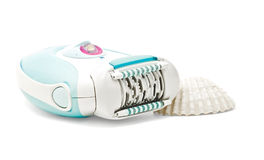 Epilator and sea shell Stock Photos
