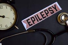 Epilepsja na druku papierze z opieki zdrowotnej pojęcia inspiracją budzik, Czarny stetoskop obrazy stock