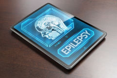Epilepsy. Tablet with epilepsy diagnosis on wooden desk stock images