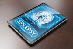 Epilepsy. Tablet with epilepsy diagnosis on wooden table Stock Photography