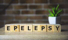 EPILEPSY word on wooden cubes, background. Concept of epilepsy awareness