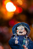 Epiphany. Closeup of old hag toy with lights christmas tree in background Stock Photos
