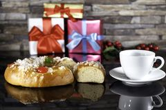 Epiphany cake and cup. Of coffe with  Christmaspresents and mistletoe Royalty Free Stock Photos
