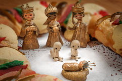 Epiphany cake, kings cake, or rosca de reyes. With manger on wooden table Stock Photography
