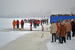 Epiphany (Kreshchenya) morning in Kiev, Ukraine,. KIEV - JAN 19: Epiphany (Kreshchenya) morning on January 19, 2013 in Kiev, Ukraine. People plunging into ice Stock Photo