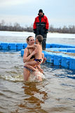 woman with kid in cold water, Kiev, Ukraine, Stock Photos