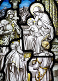 The Epiphany in stained glass (three kings visiting baby Jesus) Stock Photography