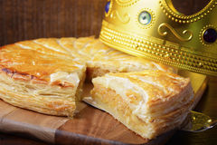 Epiphany Twelfth Night Cake. Almond Galette des Rois, Cake of the Kings, on dark wood rustic background Stock Photography