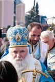 Epiphany (Vodici, Bogojavlenje) in Macedonia. STRUGA, MACEDONIA - JANUARY 19, 2012: An orthodox priest during the Epiphany (Vodici, Bogojavlenje, commemoration Royalty Free Stock Photography