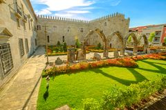 Episcopal Palace and Arcade. Beautiful aerial view of architectural complex with flowery public garden outdoor of Episcopal Palace with medieval arcade in Praca Stock Photography