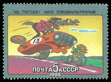 Episode from the cartoon. USSR - stamp 1988: Color edition dedicated to Soviet cartoons, shows Episode from the cartoon Nu Pogodi royalty free stock image