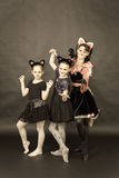 Episode of funny play in retro style. Three girls in cat costume Royalty Free Stock Photos