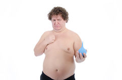Episodes. Fat man. Naked and dressed. Studio, white background. Comic situations. Funny pictures. Weight loss. Training in the fitness room. Health problems Stock Photo