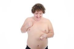 episodi Uomo grasso Nudo e vestito Fotografie Stock Libere da Diritti