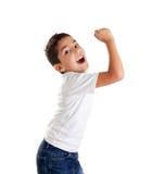 Epression emocionado del cabrito de los niños con gesto del ganador Foto de archivo