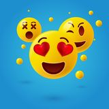 Smiley face icons or yellow emoticons with emotional funny faces in glossy 3D realistic Stock Photography