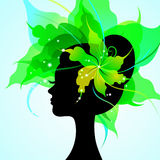 EPS10 silhouette of a beautiful young woman. With flowers in hair royalty free illustration