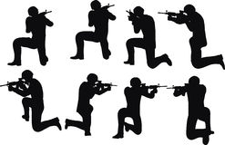 EPS 10 Vector illustration in silhouette of businessman soldier shoot Stock Image