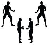 EPS 10 vectorillustratie van voetballersilhouet in zwarte Stock Afbeeldingen