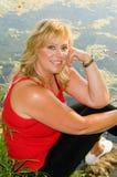 ξανθή όμορφη γυναίκα γοητ&epsilo Στοκ Φωτογραφία