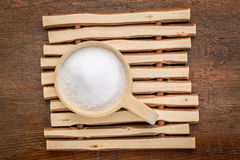 Epsom salts (Magnesium sulfate). In a rustic wooden scoop - relaxing bath concept Stock Photo