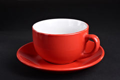 Epty red cup at the plate Royalty Free Stock Photography