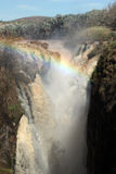 Epupa Wasserfall mit Regenbogen stockfoto