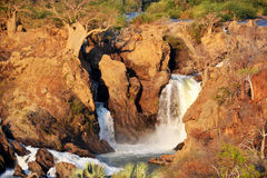 Epupa Waterfall. The Epupa Falls are created by the Kunene River on the border of Angola and Namibia, in the Kaokoland area of the Kunene Region Royalty Free Stock Images