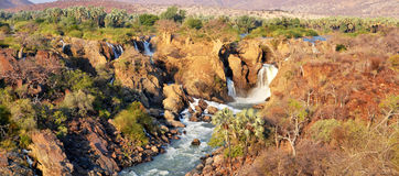Epupa Waterfall. The Epupa Falls are created by the Kunene River on the border of Angola and Namibia, in the Kaokoland area of the Kunene Region Stock Photo