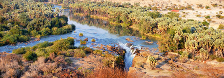 Epupa Waterfall. The Epupa Falls are created by the Kunene River on the border of Angola and Namibia, in the Kaokoland area of the Kunene Region Royalty Free Stock Image