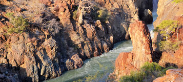 Epupa Waterfall. The Epupa Falls are created by the Kunene River on the border of Angola and Namibia, in the Kaokoland area of the Kunene Region Stock Photos