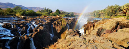 Epupa Waterfall. The Epupa Falls are created by the Kunene River on the border of Angola and Namibia, in the Kaokoland area of the Kunene Region Royalty Free Stock Photo