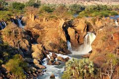 Epupa Waterfall. The Epupa Falls are created by the Kunene River on the border of Angola and Namibia, in the Kaokoland area of the Kunene Region Stock Image