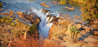 Epupa Waterfall. The Epupa Falls are created by the Kunene River on the border of Angola and Namibia, in the Kaokoland area of the Kunene Region Stock Images