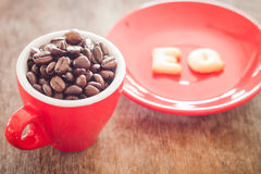 EQ alphabet biscuit with red coffee cup Royalty Free Stock Photos