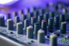 Eq controls on a home studio mixing desk. Close up of a pro mixing desk in a home recording studio royalty free stock photos