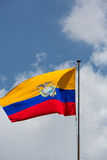 Equador flag waving with cloudy blue sky Stock Photography