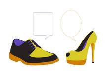 Equal dialogue between colorful shoes. Equal dialogue between man's and woman's colorful shoes, vacant text bubbles next to them Stock Photos