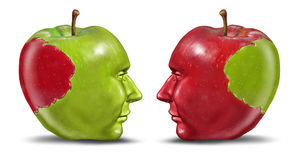 Equal Partners. And business relationship concept with a green and red apple in the shape of a human head with a bite transplanted from one partner to the other Royalty Free Stock Photography