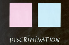 Equality. Blue and pink paper in a blackboard Stock Images
