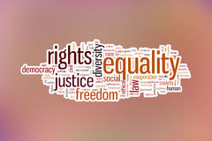 Equality concept word cloud background on blue blurred background. Equality concept word cloud background on a pastel blurred background stock images
