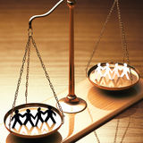 Equality Of Races. Scales of justice equaling races without prejudice or racism. Clipping path included Stock Photos