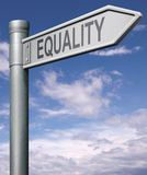 Equality road sign. Indicating way to equal rights and equal opportunities no discrimination but solidarity black and white able and disable man and women Stock Photography