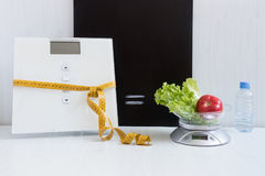 Equality of two types of scales - floor and kitchen Royalty Free Stock Photos