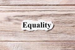 Equality of the word on paper. concept. Words of Equality on a wooden background.  stock photos