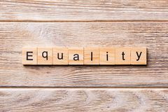 Equality word written on wood block. Equality text on wooden table for your desing, concept royalty free stock image