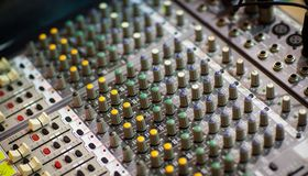 Equalizer device for recording and reproduction of sound. Close up equalizer device slide for recording and reproduction of sound, Music production mixer Stock Photo