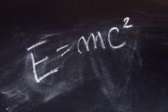 Equation. Energy formula on a blackboard royalty free stock photography
