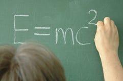Equation. Someone writing quation on blackboard royalty free stock photos